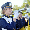WARREN DILLAWAY / Star Beacon<br /> TYLER STRATER, plays the trombone for the Conneaut High School band  on Friday evening during opening night action in Conneaut.