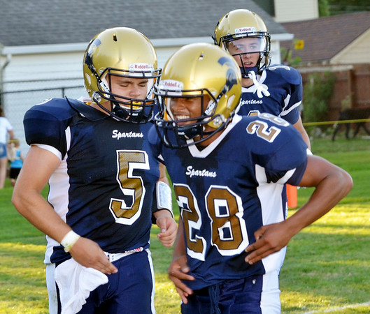 WARREN DILLAWAY / Star Beacon<br /> CURTIS FRANKLIN (28) celebrates with Conneaut teammate Troy Colucci after Colucci scored a first half touchdown on Friday evening against Grand Valley at Conneaut.