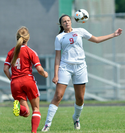 WARREN DILLAWAY / Star Beacon<br /> ABBIE SCHLICK (9) of Edgewood tries to control the ball in front of Summer Arndt (4) of Geneva on Saturday at Edgewood.