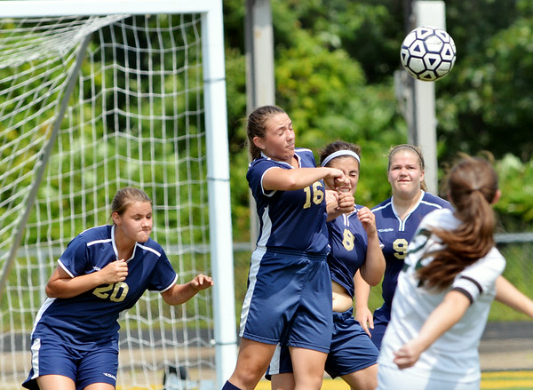 WARREN DILLAWAY / Star Beacon<br /> LAURA STRUBBE (24) of Lakeside hooks the ball over Conneaut defenders (from left) Sierra Brink, Michaella Rogers, Jasmine Henson and Kirsten Whitbread  on Saturday during a match at Lakeside. The ball found its way in to the net for the  only goal of the game.