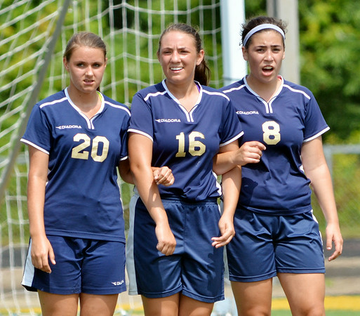 WARREN DILLAWAY / Star Beacon<br /> CONNEAUT DEFENDERS (from left) Sierra Brink, Michaella Rogers and Jasmine Henson lock arms before a penalty kick on Saturday during a match at Lakeside. Laura Strubbe of Lakeside connected on the free kick for the only goal of the game.