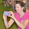 WARREN DILLAWAY / Star Beacon<br /> SARAH LOVELAND, of Roaming Shores, takes pictures during the frog jumping contest at the 124th Pierpont Picnic in Pierpont Township on Saturday.