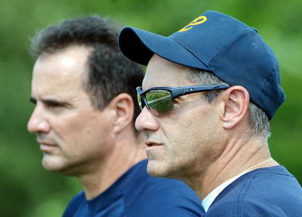 WARREN DILLAWAY / Star Beacon<br /> CONNEAUT GIRLS soccer coach John Coccitto (left) and assistant Joe Chadwick watch the action on Saturday at Lakeside.