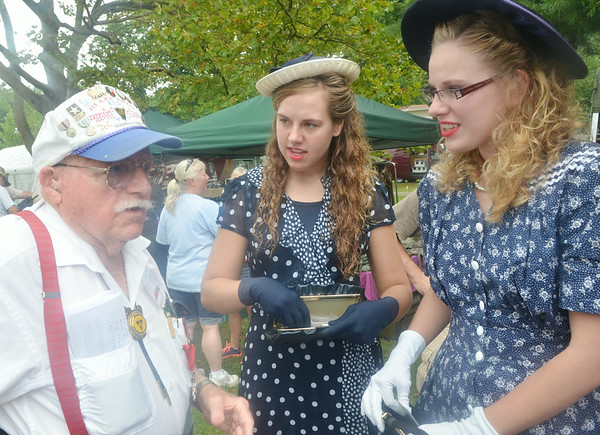 WARREN DILLAWAY / Star Beacon<br /> FREDERICK PEARSON of Madison Township talks with Amanda (center) and Hannah Zandstra, both of Holland, Mich., during D-Day Conneaut preparations at Conneaut Township Park in Conneaut, Ohio.