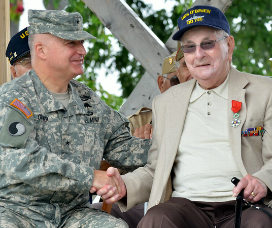 WARREN DILLAWAY / Star Beacon<br /> RAY WOODS (right) of Ottawa, OH, is congratulated by Brigadier General, Virginia National Guard Land Component Commander Blake C. Ortner after Woods received the French Legion of Honor from French Consul Honoraire Josh Knerly Jr. during a D-Day Conneaut ceremony at Conneaut Township Park.