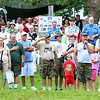 WARREN DILLAWAY / Star Beacon<br /> VISITORS TO  D-Day Conneaut pay their respects during flag raising ceremony at Conneaut Township Park.