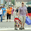 WARREN DILLAWAY / Star Beacon<br /> RAY BLACK and his 14 month old son Anthony, both of Erie, check out the Wine and Walleye Festival on Saturday in Ashtabula.