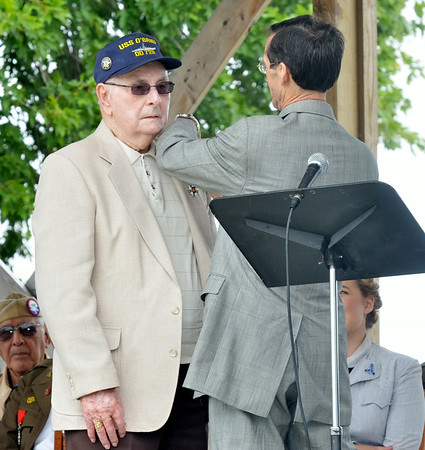 WARREN DILLAWAY / Star Beacon<br /> RAY WOODS (left) of Ottawa, OH, receives the French Legion of Homor from French Consul Honoraire Josh Knerly Jr. during a D-Day Conneaut ceremony at Conneaut Township Park.