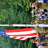 WARREN DILLAWAY / Star Beacon<br /> THE RAISING of the American Flag was just one of many moving experiences on Saturday during D-Day Conneaut at Conneaut Township Park.