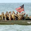 WARREN DILLAWAY / Star Beacon<br /> AN AMERICAN landing craft brings troops to shore on Saturday during D-Day Conneaut at Conneaut Township Park.