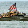 WARREN DILLAWAY / Star Beacon<br /> A WORLD WAR II era landing craft transport troops the D-Day Conneaut invasion on Saturday at Conneaut Township Park.