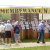 WARREN DILLAWAY / Star Beacon<br /> VISITORS TO the Remembrance Wall review World War II history during D-Day Conneaut at Conneaut Township Park on Satuday.