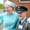 WARREN DILLAWAY / Star Beacon<br /> EARL HEUSINGER SR. of Buffalo talks with Tiffany Zandstra,  of Holland, Mich., during D-Day Conneaut preparations at Conneaut Township Park in Conneaut, Ohio.