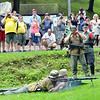 WARREN DILLAWAY / Star Beacon<br /> GERMAN RE-ENACTORS give a gun demonstration during Conneaut D-Day activities on Friday at Conneaut Township Park.