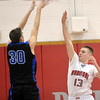 WARREN DILLAWAY / Star Beacon<br /> MASON LILJA (13) of Edgewood leaps to block a shot by tom Bell of Lakeview on Tuesday evening at Edgewood.