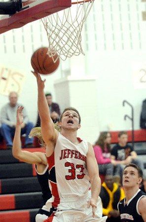 WARREN DILLAWAY / Star beacon<br /> SAM HITCHCOCK of Jefferson drives to the basket on Tuesday evening during a home game with Struthers.