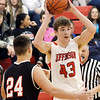 WARREN DILLAWAY / Star beacon<br /> BLAKE PAYNE of Jefferson prepares to pass the ball as Louis Mateo (24) of Struthers defends on Tuesday evening during a home game with Struthers.