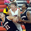 WARREN DILLAWAY / Star Beacon<br /> BLAKE PAYNE (center) of Jefferson battles for position with Austin Yemma (21) and Ray Phifer (4), both of Struthers, on Tuesday night at Jefferson