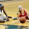 WARREN DILLAWAY / Star Beacon<br /> EMILY HARRIMAN (right) of Geneva and Dazhae Campbell of Lakeside hit the floor on Saturday at Lakeside.