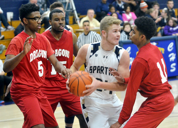WARREN DILLAWAY / Star Beacon<br /> MARCUS BARRICKMAN (with ball) of Conneaut tries to maneuver between Horizon Academyyy defenders Greg Rollins (5), Denzell Jones (15) and Marlon Lopez (11) on Saturday afternoon in Conneaut.