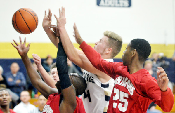 WARREN DILLAWAY / Star Beacon<br /> MARCUS BARRICKMAN (in white) battles for the ball with Eric Maxwell (25) of Horizon Academy on Saturday afternoon at Garcia Gymnasium in Conneaut.
