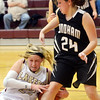 WARREN DILLAWAY / Star Beacon<br /> MEGAN STECH  (with ball) of Pymatuning Valley and Samantha Dean of Windham battle for the ball  on Monday night in Andover Township.