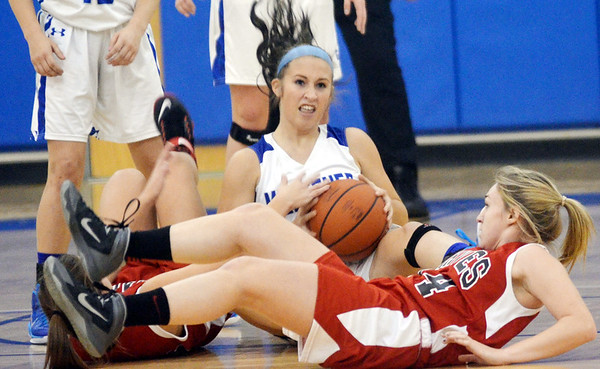 WARREN DILLAWAY / Star Beacon<br /> TAYLOR HUFFMAN (with ball) of Grand Valley and Taylor Kramar of Badger hit the deck on Monday night in Orwell.