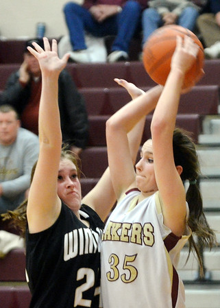 WARREN DILLAWAY / Star Beacon<br /> MADISON HURST (35)  of Pymatuning Valley prepares to pass as Samantha Dean of Windham defends on Monday evening in Anndover Towwnship.