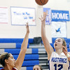 WARREN DILLAWAY / Star Beacon<br /> JESSICA VORMELKER (12) of Grand Valley lofts a shot over a Badger defender on Monday night in Orwell.