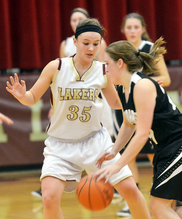 WARREN DILLAWAY / Star Beacon<br /> KAT HALL (35)  of Pymatuning Valley defends Samantha Dean of Windham on Monday evening in Andover Towwnship.