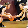 WARREN DILLAWAY / Star Beacon<br /> REBECCA DILLON (right) of Grand Valley and Carlie Kiser (left) of Windham battle for the ball  on Monday night in Andover Township.