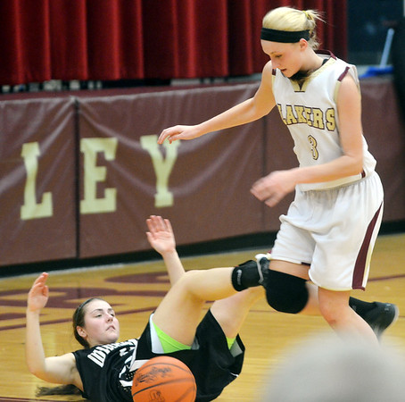WARREN DILLAWAY / Star Beacon<br /> KELSEA BROWN (right) of Pymatuning Valley and Carlie Kiser (left) of Windham battle for the ball  on Monday night in Andover Township.