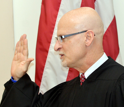 WARREN DILLAWAY / Star Beacon<br /> NEWLY ELECTED Ashtabula County Juvenile and Propate Judge Albert Camplese takes the oath of office on Monday afternoon in the Ashtabula County commissioners meetting room.