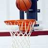 WARREN DILLAWAY / Star Beacon<br /> THE BALL hangs over the rim during a basketball game at Geneva.