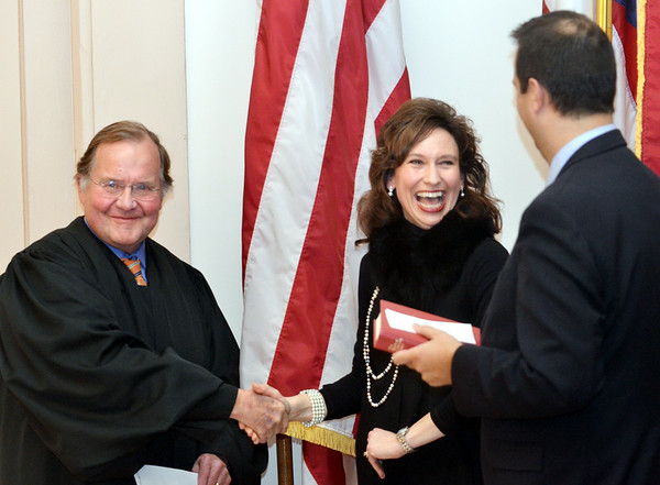 WARREN DILLAWAY / Star Beacon<br /> MARIANNE SEZON laughs with her husband Richard Dana (right) after she was sworn in as Ashtabula County Common Pleas Court judge. She is the first known female common pleas judgein the history of Ashtabula County. Retiring common pleas judge Alfred Mackey (left) presided over her swearing in ceremony in the Ashtabula County commissioners meeting room in Jefferson.