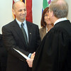 WARREN DILLAWAY / Star Beacon<br /> ASHTABULA COUNTY Prosecutor Nicholas Iarocci shakes hands with incoming Ashtabula County Common Pleas Judge Thomas Harris after Iarocci took the prosecutor oath of office.