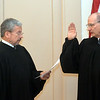 WARREN DILLAWAY / Star Beacon<br /> DAVE SCHROEDER (right) takes the oath of office as Western County Court judge from Ohio Supreme Court  Justice William O'Neil.