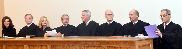 WARREN DILLAWAY / Star Beacon<br /> AREA JUDGES prepare for oath of office ceremonies on Monday at the Ashtabula County commissioners meeting room in Jefferson.  (From left) Ashtabula County Common Pleas Court incoming judges Marianne Sezon and Thomas Harris, 11th District Court of Appeals Judge Cynthia Westcott Rice; Ohio Supreme Court Justice William O'Neil; 11th District Court of Appeals Judge Timothy Cannon, incoming Ashtabula County Juvenile and Probate Court Judge Albert Camplese; Western County Court Judge David Schroeder and Ashtabula County Common Pleas Court Judge Gary Yost.