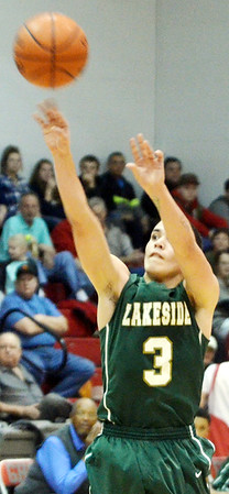 WARREN DILLAWAY / Star Beacon<br /> JOSE RAMOS of Lakeside shoots on Tuesday night during a  game at Geneva.
