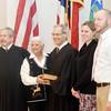 WARREN DILLAWAY / Star Beacon<br /> ASHTABULA COUNTY Common Pleas Judge Gary Yost (middle) was sworn  in for his final term by Ohio Supreme  Court Justice William O'Neill (far left) as Yost's wife Bonnie held the Bible (second from left) and children Megan Franklin and David Yost look on.