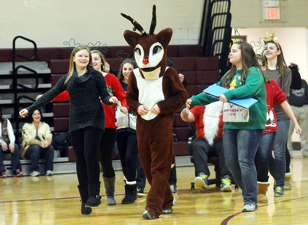 WARREN DILLAWAY / Star Beacon<br /> THE SOPHOMORE Pymatuning Vallety Reindeer Games dance gets started with (from left front) Katie Stokes, Austin Limestoll (Rudolph) and Sophia Hochran leading     the way on Friday afternoon in Andover Township.