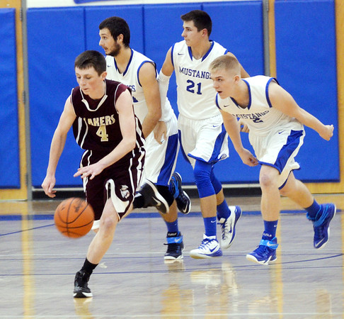 WARREN DILLAWAY / Star Beacon<br /> DALTON MORGAN of Pymatuning Valley (4) leads a break with Grand Valley defenders Zach Oscar (far lefft back), Michael McGovern, (21), and Austin Spoon (2) in  hot pursuit on Friday evening in Orwell.