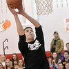 WARREN DILLAWAY / Star Beacon<br /> BLAKE PERRY competes in the slam dunk competition during the Reindeer Games at Jefferson High School on Friday.
