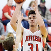 WARREN DILLAWAY / Star Beacon<br /> LUCAS HITCHCOCK of Jefferson shoots over Mitchell Dragon of Edgewood on Friday evening in Jefferson.
