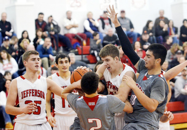 WARREN DILLAWAY / Star Beacon<br /> BLAKE PAYNE (with ball) of Edgewood pulls down a rebound in front of Edgewood's Justin Searles (2) and Jeff Gonzalez (right with aaaarm sleeve) and Jefferson teammates Sam Hitchcock (35) and Jacob Adams (back left) on Friday evening in Jefferson.