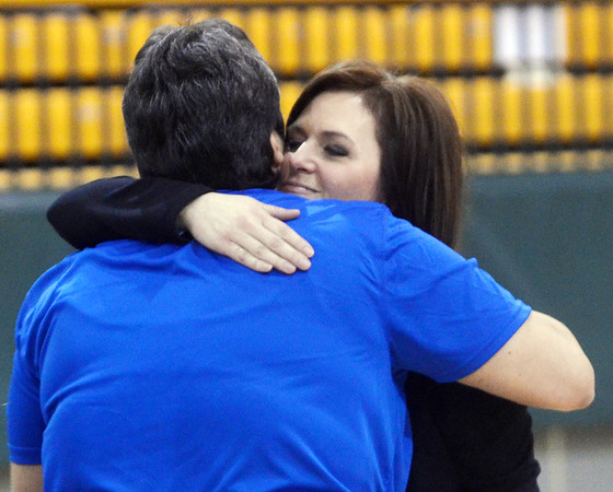 WARREN DILLAWAY / Star Beacon<br /> JODI CANDELA, a former assistant girls basketball coach to Rob Livingston (back to camera) hugs Livingston's wife Carita on Saturday afternoon at Lakeside during a memorial to the coach.