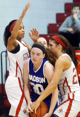 WARREN DILLAWAY / Star Beacon<br /> ALY BERRY (30) of Madison is caught between Geneva defenders Hailey Peoples (left) and Sarah Juncker (right)on Saturday at Geneva.