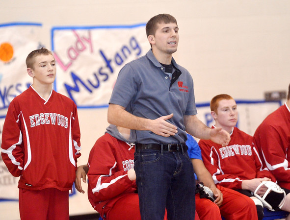 WARREN DILLAWAY / Star Beacon<br /> GREGORY STOLFER, the new Edgewood wrestling coach, instructs his team on Saturday during the Grand Valley Duals in Orwell.
