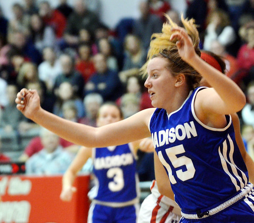 WARREN DILLAWAY / Star Beacon<br /> JULIE BRUENING (15) of Madison reacts to the ball on Saturday during a game at Geneva.