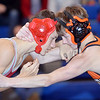 WARREN DILLAWAY / Star Beacon<br /> ANDREW HULL (left) of Edgewood wrestles Justin Rayon of Chagrin Falls during a 106 pound bout at the Grand Valley Duals on Saturday in Orwell.